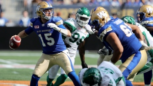 Winnipeg Blue Bombers' quarterback Matt Nichols (15) looks to pass before being sacked during the first half of CFL football action against the Saskatchewan Roughriders' in Winnipeg, Saturday, September 9, 2017. (Source: Trevor Hagan/The Canadian Press)