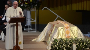 The relics of Madre Laura, Colombia's only Roman Catholic saint, are on display as Pope Francis addresses seminarians, nuns and Catholic families during a meeting at La Macarena event center in Medellin, Colombia, Saturday, Sept. 9, 2017. (AP Photo / Luis Benavides)