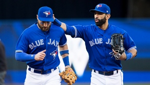 Toronto Blue Jays centre fielder Kevin Pillar, left, is congratulated by teammate Jose Bautista after making an inning-ending catch in fifth inning American League MLB baseball action against the Detroit Tigers in Toronto on Saturday, September 9, 2017. (THE CANADIAN PRESS / Aaron Lynett)
