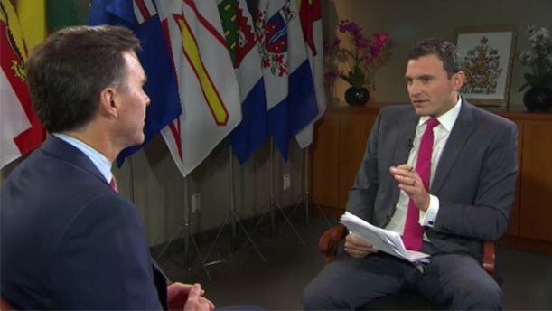 Finance Minister Bill Morneau and host of CTV's Question Period Evan Solomon.
