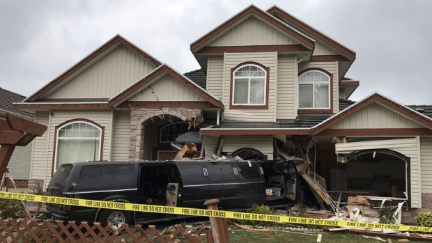 This stretch limousine crashed into a Surrey home just after 3:10 a.m. on Sept. 10, 2017. Police say the structure could collapse if the vehicle is removed. (CTV)