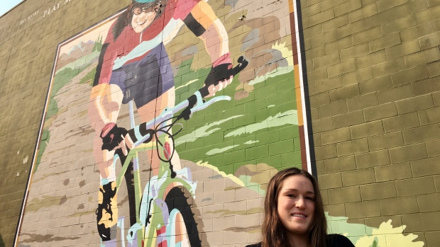Lea McCroy, 17, poses for a photo in front of a Canmore mural in memory of her mom, Isabelle Dube, who was killed in a grizzly bear attack in June 2005, in Canmore, Alta. (THE CANADIAN PRESS/Colette Derwoiz)