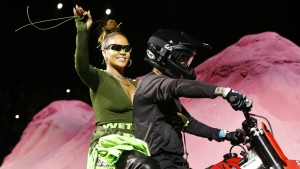 Rihanna rides on a motorcycle after showing her fashion collection from Fenty Puma by Rihanna during Fashion Week in New York on Sunday, Sept. 10, 2017. (AP / Bebeto Matthews)