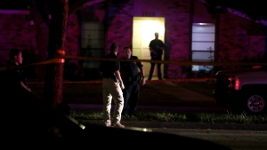 Police officers work the scene of a shooting at a home in Plano, north of Dallas, Texas, Sunday night, Sept. 10, 2017. (Vernon Bryant / The Dallas Morning News)