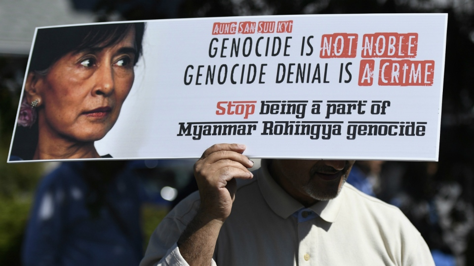 A man protests against Burmese leader Aung San Suu Kyi during a solidarity rally for the Rohingya in Myanmar, outside the Embassy of Myanmar in Ottawa on Sunday, Sept. 10, 2017. (Justin Tang / THE CANADIAN PRESS)