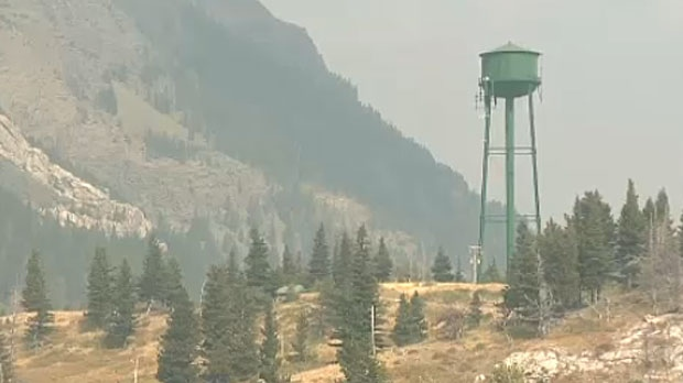 Parks Canada officials, police and firefighters are the only people left in the Town of Waterton Lake after support staff were told to leave on Sunday night.