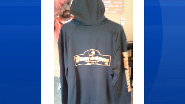 "Police say the sweat shirts say ""The Open Sky Adventures"" on the front and ""DEEPELLING"" on the left sleeve. (New Brunswick RCMP)"