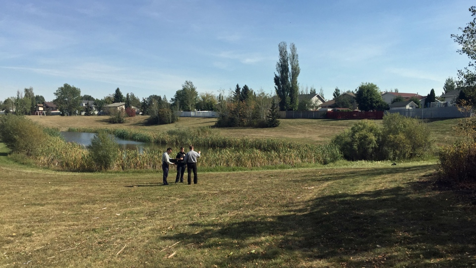 Saskatoon police investigate at a pond near Dundonald School. A boy, pronounced dead in hospital, was found in the pond Monday, Sept. 11, 2017. (Angelina Irinici/CTV Saskatoon)