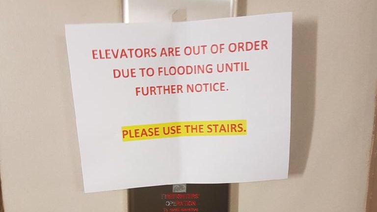 A sign warns residents of 294 Chandler Drive that their elevators are out of service.