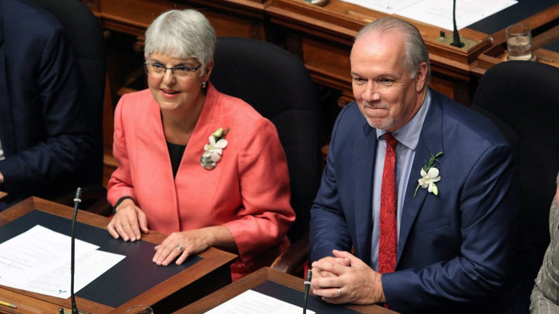 Premier John Horgan and Deputy Premier Carole James look on before the speech from the throne in the legislative assembly in Victoria on Sept. 8, 2017. THE CANADIAN PRESS/Chad Hipolito