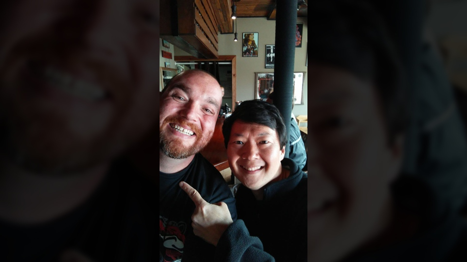 Actor Ken Jeong, right, poses for a picture with Dan Byron, left, for Byron's birthday after the star visited restaurant Route 14 in Sooke. Sept. 8, 2017. (Facebook)