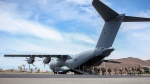 In this undated photo provided on Sunday Sept. 10, 2017, by the British Ministry of Defence, 40 Commando Royal Marines disembark from the new RAF A400M as they arrive on the British Virgin Islands to provide humanitarian assistance to British Overseas Territories. The death toll from Hurricane Irma has risen to 22 as the storm continues its destructive path through the Caribbean. (Joel Rouse/MOD via AP)