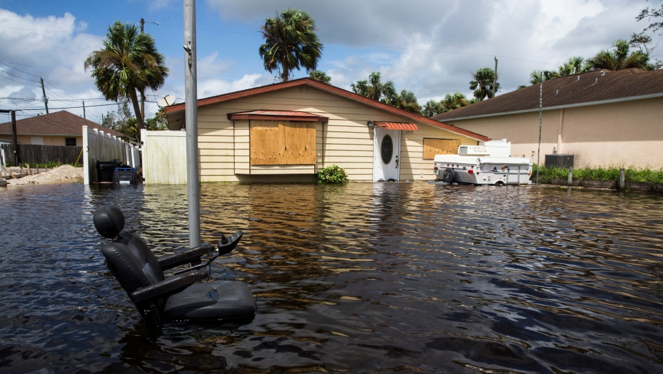 Floodwater caused by Hurricane Irma in Bonita Springs, Fla., surrounds a home on Monday, Sept. 11, 2017. (Nicole Raucheisen/Naples Daily News via AP)