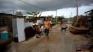 A man walks among the belongings of those affected by Hurricane Irma in Isabela de Sagua, Cuba, Monday, Sept. 11, 2017. (AP Photo / Ramon Espinosa)