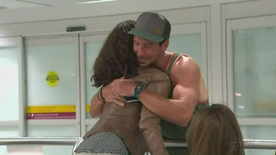 A Canadian tourist enjoys a cheerful reunion at Pearson Airport on Sept. 11, 2017 after living through Hurricane Irma.