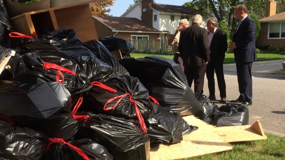Minister of Municipal Affairs Bill Mauro tours flooded-damaged area on Kildare Road in Windsor, Ont., on Tuesday, Sept. 12, 2017. (Michelle Maluske / CTV Windsor)