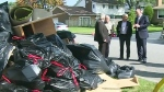 Mayors from Windsor-Essex join Municipal Affairs Minister Bill Mauro to survey some of the flood-damaged debris after a record rainfall at the end of August flooded more than 6,000 homes. (Michelle Maluske/CTV Windsor)