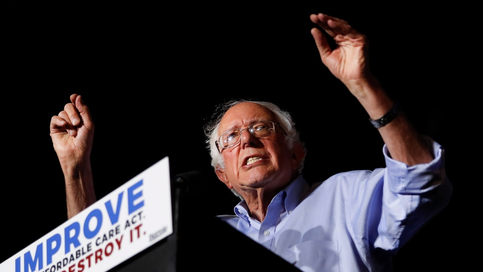 In this July 9, 2017 photo, Sen. Bernie Sanders, I-Vt., speaks during a 'Care Not Cuts' rally in support of the Affordable Care Act in Covington, Ky. (AP Photo/John Minchillo)