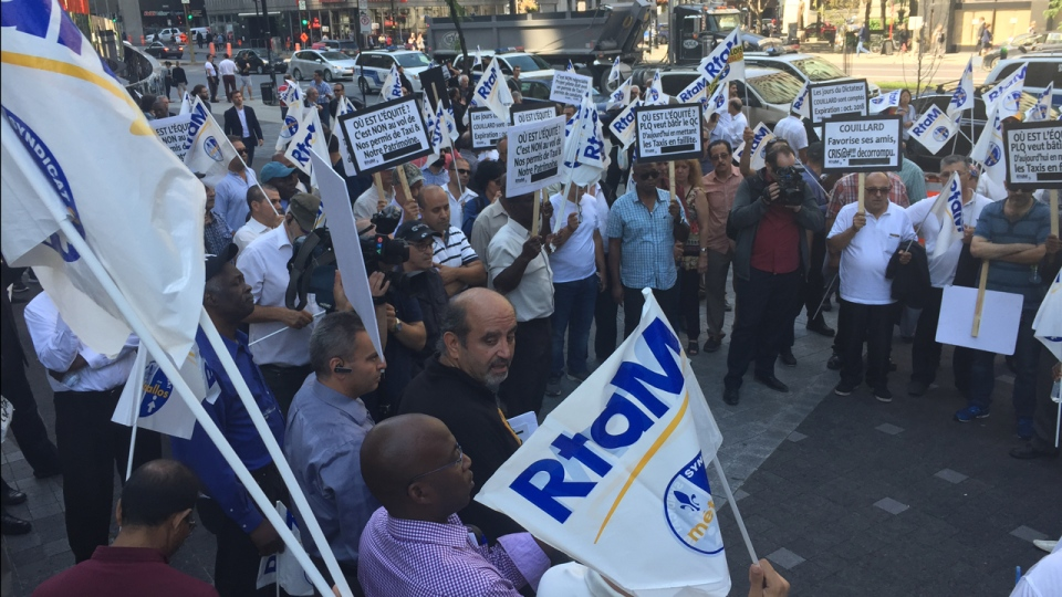About 100 taxi drivers and owners protested on Wednesday, Sept. 13, 2017 in downtown Montreal