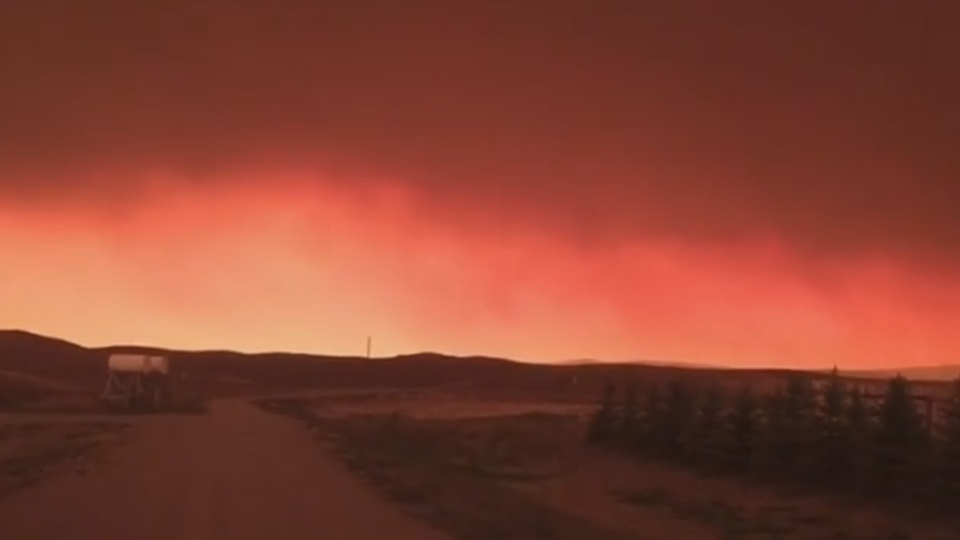A red sky is shown near Waterton Lakes National Park in Alberta, in this still image from video posted on Sept. 12, 2017. (Instagram / mommajokegs)
