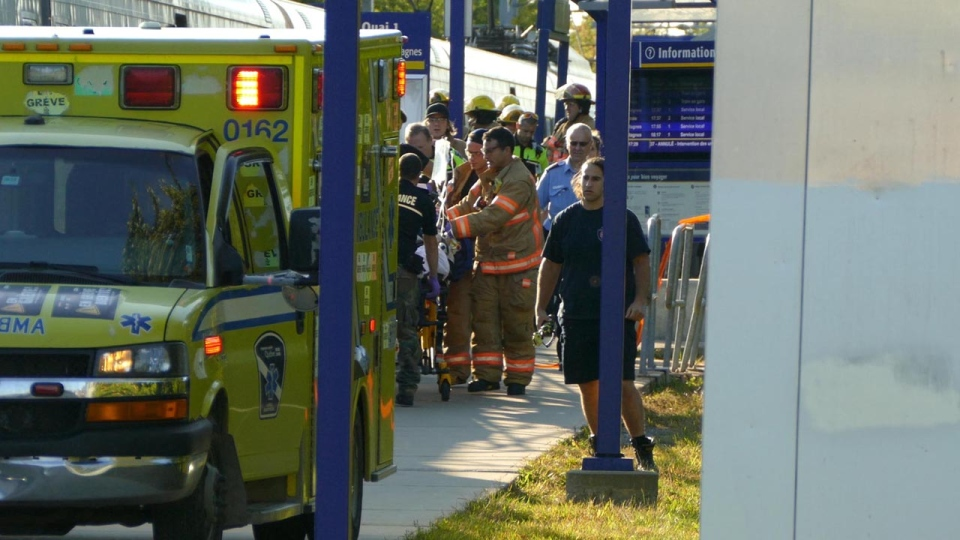 First responders place a teenaged girl in an ambulance after she was hit by a train at the Roxboro-Pierrefonds station on Sept. 12, 2017 (Pascal Marchand)