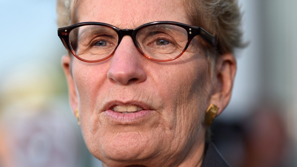 Ontario Premier Kathleen Wynne talks to media after appearing as a witness in the Election Act bribery trial in Sudbury, Ontario, Wednesday, Sept. 13, 2017. (THE CANADIAN PRESS/Sean Kilpatrick)