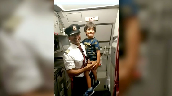 Jillian Murphy's son and the airline captain are seen in this photo.