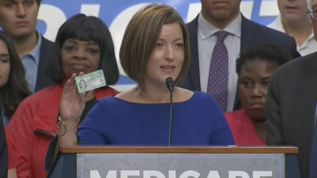 Canadian doctor shows off her health card at Bernie Sanders' Medicare bill launch