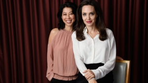 "In this Sept. 11, 2017 photo, Angelina Jolie, right, director/co-writer of the film ""First They Killed My Father: A Daughter of Cambodia Remembers,"" and co-writer/human rights activist Loung Ung pose for a portrait during the Toronto International Film Festival in Toronto. (Photo by Chris Pizzello/Invision/AP)"