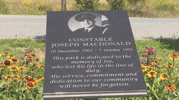 A look at a plaque displayed at Joe MacDonald Memorial Park.