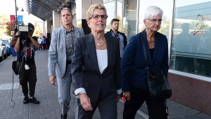 Ontario Premier Kathleen Wynne (left), accompanied by her partner Jane Rounthwaite, leaves after appearing as a witness in the Election Act bribery trial in Sudbury, Ontario, Wednesday, Sept. 13, 2017. THE CANADIAN PRESS/Sean Kilpatrick