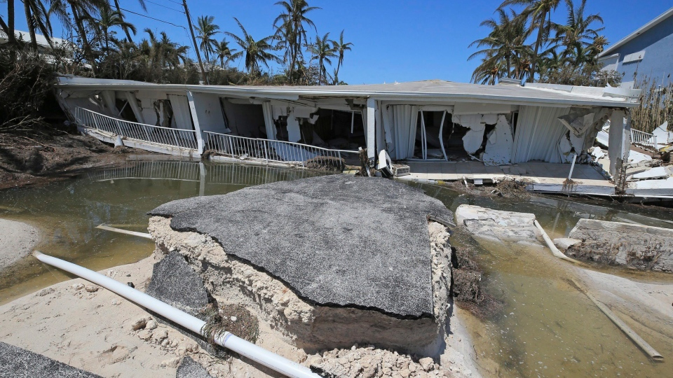 Floodwaters surround the remnants of a condominium near Islamorada along the Overseas Highway in the Florida Keys, Tuesday, Sept. 12, 2017. (Al Diaz / Miami Herald via AP)