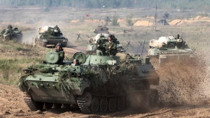 In this photo taken on Monday, Sept. 11, 2017, Belarusian army vehicles drive preparing for war games at an undisclosed location in Belarus. Russia and Belarus are holding a massive war games, Zapad 2017, that due to start on Thursday near the borders of Poland, Estonia, Latvia and Lithuania. (Vayar Military Agency photo via AP)