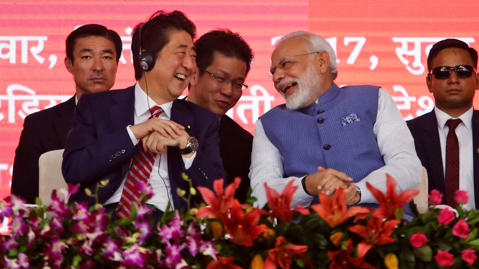 Japanese Prime Minister Shinzo Abe, left, and Indian Prime Minister Narendra Modi laugh during the launch of work on a high-speed train line in the western Indian state of Gujarat, in Ahmadabad, India, Thursday, Sept. 14, 2017.  (AP Photo/Ajit Solanki)