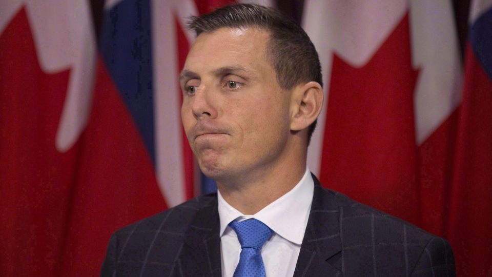 Ontario Provincial Conservative Leader Patrick Brown answers questions from the media following the Lieutenant Governor of Ontario's Speech from the Throne, opening the second session of the 41st Parliament of Ontario, in Toronto on Monday, Sept. 12, 2016. (THE CANADIAN PRESS/Peter Power)