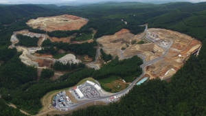 In this undated photo provided on Monday, Sept. 11, 2017 by Hellas Gold company, an aerial view of a gold mine complex in Skouries, in the Halkidiki peninsula, northern Greece. Canadian mining company Eldorado Gold on Monday threatened to suspend a major investment in Greece in ten days, accusing the government of delaying permits and licenses. (Hellas Gold via AP)