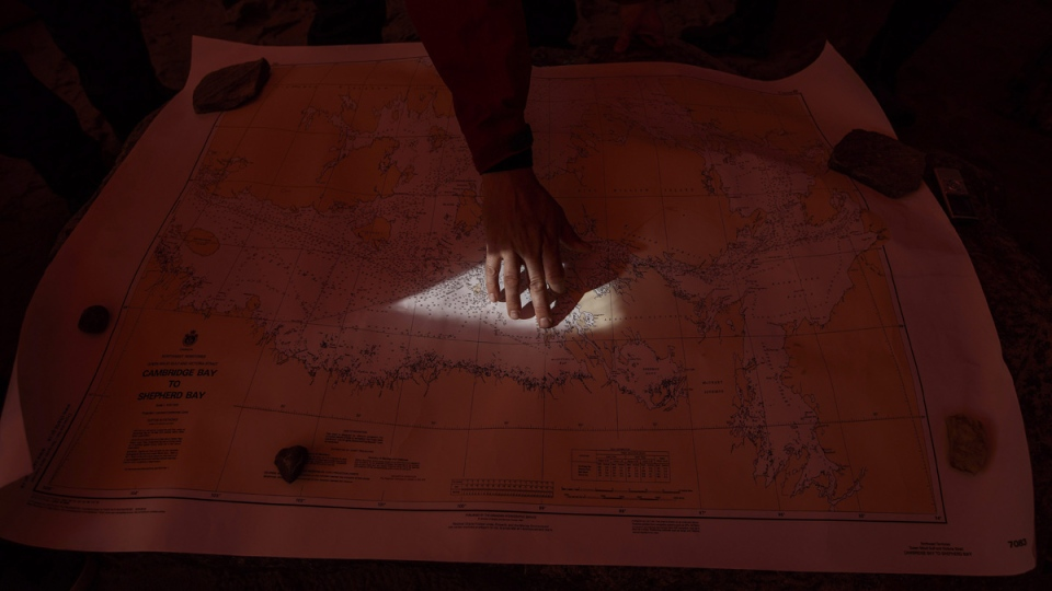 Ryan Harris, Parks Canada, lead underwater archeologist for the Erebus and Terror points out on a map the area where the sunken ships are near Gjoa Haven Nunavut, on Sept. 1, 2017. THE CANADIAN PRESS/Jason Franson
