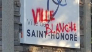 Graffiti reading 'White Town,'' is shown in this image provided by Saint-Honore Mayor Bruno Tremblay. Tremblay says he's called the police after a fifth incident of hateful graffiti in his town. (THE CANADIAN PRESS/HO-Bruno Tremblay)