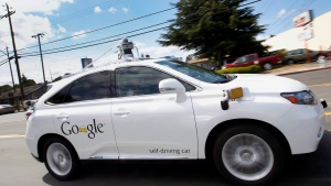Google's self-driving Lexus car drives along street during a demonstration at Google campus in Mountain View, Calif. on May 13, 2015. (Tony Avelar/THE CANADIAN PRESS/AP)