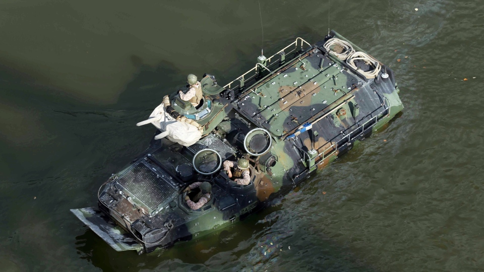 This Sept. 6, 2016, photo released by the U.S. Marine Corps shows Marines with the 2nd Amphibious Assault Battalion aboard AAV-7 Amphibious Assault Vehicles during an exercise on the Cumberland River in Nashville, Tenn. (Lance Cpl. Jack A. E. Rigsby/U.S. Marine Corps via AP)