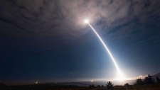 In this image taken with a slow shutter speed and provided by Vandenberg Air Force Base, an unarmed Minuteman 3 missile launches from Vandenberg Air Force Base, Calif., Wednesday, Aug. 2, 2107. (Senior Airman Ian Dudley/Vandenberg Air Force Base via AP)