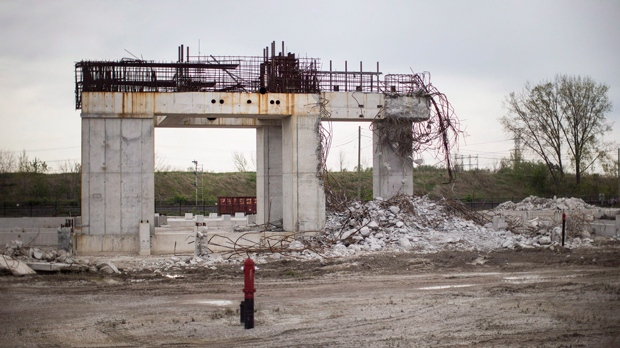 The remains of the 800-megawatt gas-fired power plant, which had it's construction canceled by the then Liberal Government of Ontario prior to the provincial general election of 2011, sits in Mississauga on May 18 2014. A trial of two former top political aides in the Ontario premier's office is slated to begin in Toronto today. David Livingston and Laura Miller are charged with breach of trust, mischief and unlawful use of a computer. The politically sensitive case involves allegations of illicit email destruction in the office of former Liberal premier Dalton McGuinty. The emails were about the Liberals' decision to cancel two gas plants just before the 2011 election, costing taxpayers about $1.1 billion. THE CANADIAN PRESS/Chris Young