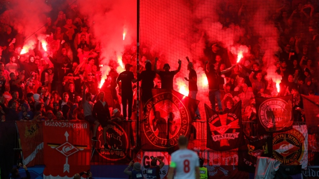 Spartak supporters light a flare