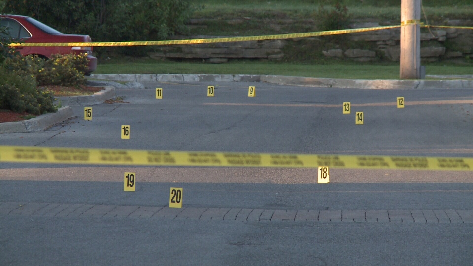 Evidence markers arranged on the pavement after a drive-by shooting in the parking lot next to a cluster of bars and restaurants at Kanata Centrum around 2:15 a.m. Thursday, Sept. 14, 2017.
