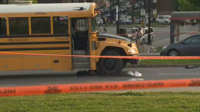 The woman was struck by a school bus.
