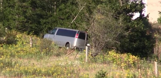 A van ends up in the ditch on Highway 401