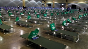 Cots are set up in a convention center transformed into a shelter for victims of Hurricane Irma, in San Juan, Puerto Rico, Thursday, Sept. 14, 2017. (AP Photo / Ricardo Arduengo)