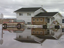 Flood waters surround homes on the Peguis First Nation, north of Winnipeg, on Sunday, April 19, 2009.