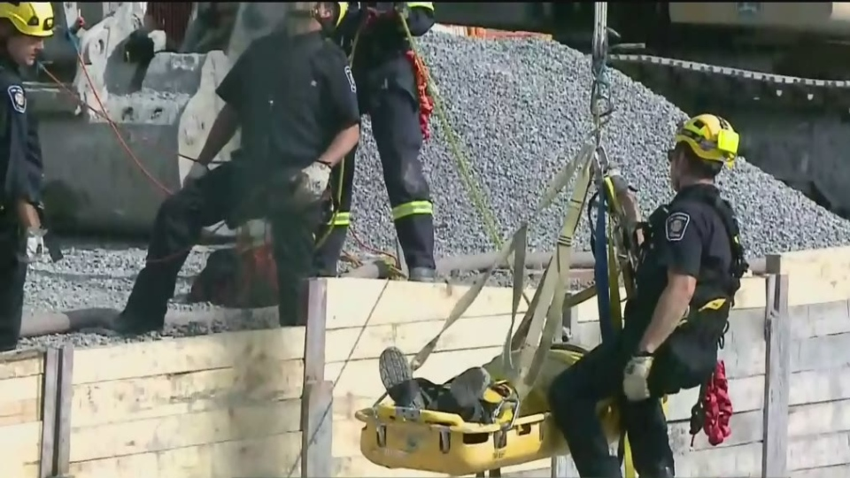 Firefighters in The High Angle Rescue team used special rigging and a special stretcher that can be hoisted from a firetruck to bring an injured man from the bottom of a construction pit up to ground level on Friday, Sept. 15, 2017.