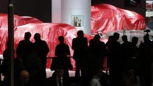 Visitors wait for the Ferrari presentation at the International Frankfurt Motor Show IAA in Frankfurt, Germany, on Sept. 12, 2017. (Michael Probst / AP)